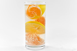 orange infused water with oranges lemon